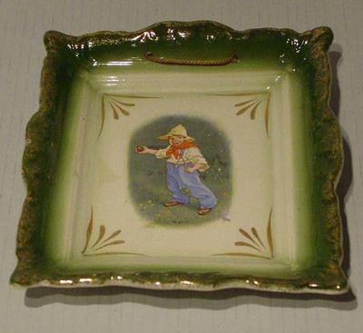 Plate, image of a  boy cricketer ball in hand