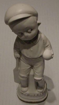Figurine, boy with cricket equipment
