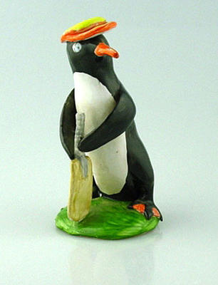 Ceramic figurine, cricketing penguin wearing Marylebone CC cap