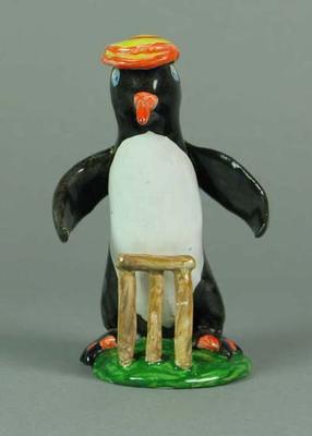 Ceramic figurine, cricketing penguin wearing Marylebone CC cap