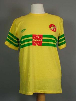 T-shirt - Yellow with green bands  and 'National' logo