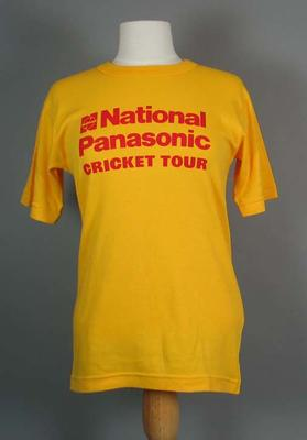 T-shirt - Yellow with 'National Panasonic Cricket Tour' in red