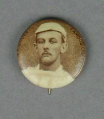 Badge with image of Norman Druce, c1897