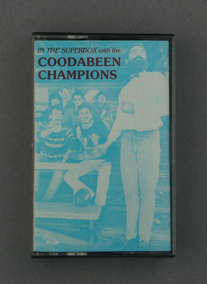 """Audio cassette case, """"In the Super Box with the Coodabeen Champions""""; Audio-Visual; M2351.7"""