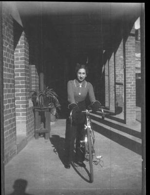 Photograph of Dot Edney with bicycle, c1939; Photography; 1988.2003.23