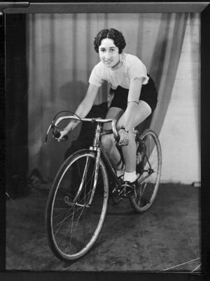 Copy negative of Dot Edney with bicycle, c1930s