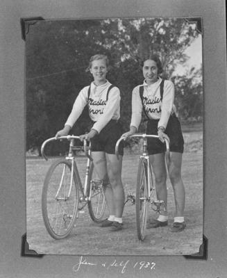 Copy negative of Dot Edney and another female cyclist with bicycles, c1930s