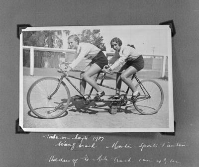Copy negative of Dot Edney and another female cyclist on tandem bicycle, c1930s