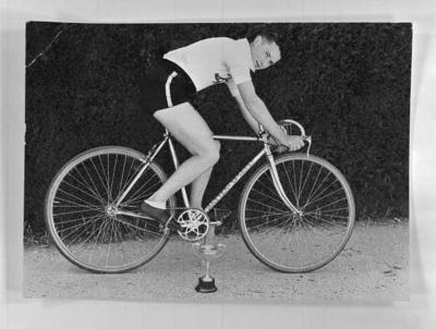 Copy negative of cyclist on a bicycle, c1930s
