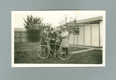 Photograph of Hubert Opperman presenting a bike to a boy, 29 March 1927