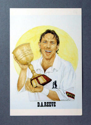 Colour postcard depicting cricketer Dermot Reeve holding a trophy
