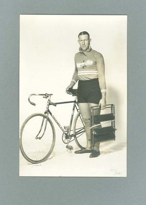 Black & white photograph of Bobbie Pearce with a bicycle