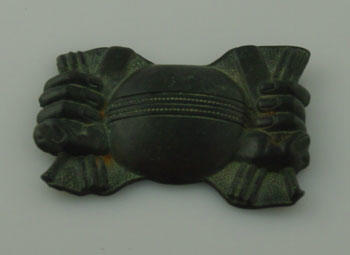 Belt buckle, featuring image of cricket ball