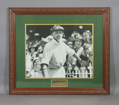 Framed photograph of Don Bradman, walking out to bat with crowd behind; Photography; Framed; M8713