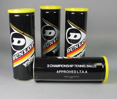 Two cylindrical metal containers, each holding four Dunlop tennis balls