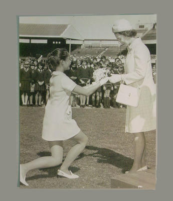 Royal Visit 1954 - Young girl presenting the Queen with bouquet at MCG
