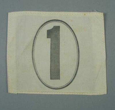 Competitor's number, worn by Winsome Cripps