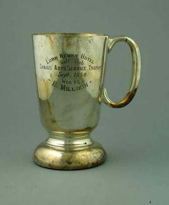 """Trophy - Tankard 'Lord Newry Hotel Gold Club, Craig's Auto Services Trophy, Sept. 1954  won by E. Milliken""""; Trophies and awards; 1993.2922.2"""
