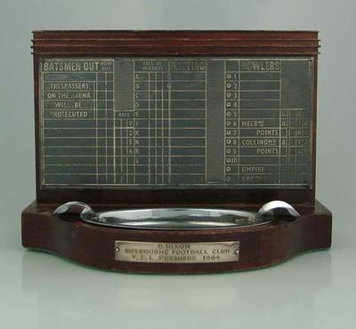Two-Part Trophy (Scoreboard Plaque with Ashtray) presented to Brian Dixon by Melbourne Football Club, VFL Premiers 1964