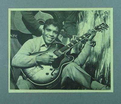 Photograph of Lionel Rose playing a guitar, c1960s-70s
