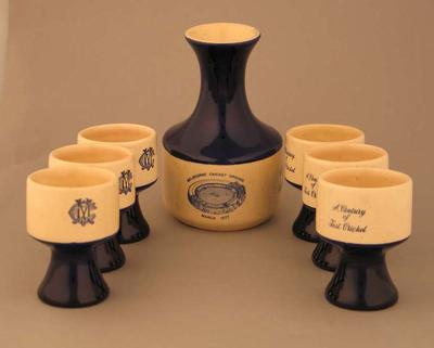 Ceramic port decanter with images of MCG, Centenary Test 1877-1977