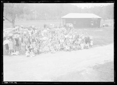 Glass negative, image of large group of people near a sports field