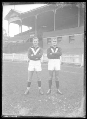 Glass negative, image of Peter Bennett and Keith Drinan wearing Victorian representative guernseys