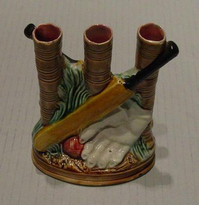 Ceramic Staffordshire spill vase featuring cricket equipment design; Domestic items; M5323