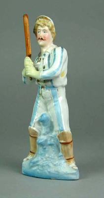 Ceramic figurine of a batsman in blue and white clothing