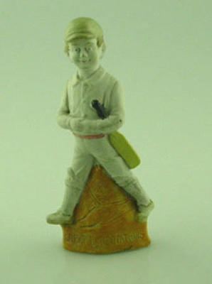 Figurine, depicts boy cricketer