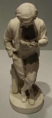 Figurine, known as 'Young England' -  boy cricketer with bat and book