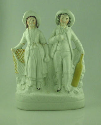 Ceramic figurine, girl and boy with sports equipment