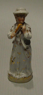 Figurine, depicts girl with tennis equipment