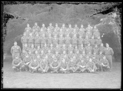 Glass negative, image of large group in military attire