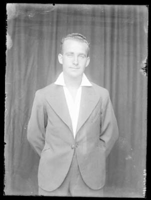 Glass negative, image of unknown man in studio setting