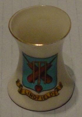 Miniature vase - inscription 'Lindfield',   coat of arms comprising cricket equipment