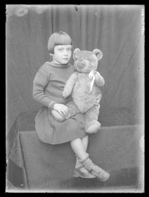 Glass negative, image of unknown young girl in studio setting