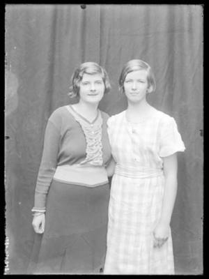 Glass negative, image of two unknown women in studio setting