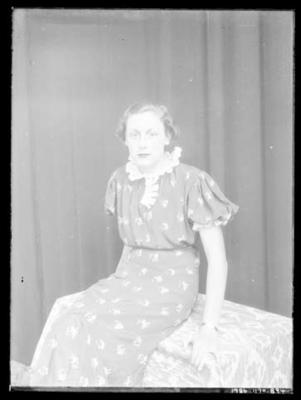Glass negative, image of unknown woman in studio setting