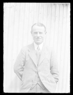 Glass negative, image of unknown man wearing suit