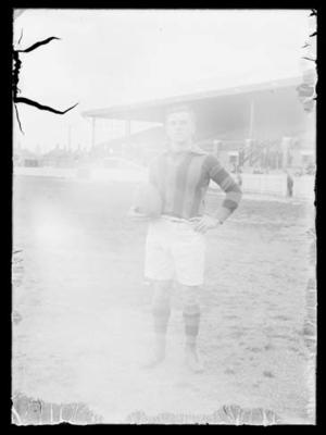 Glass negative, image of football player
