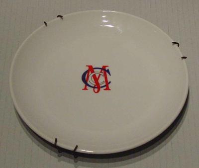 Ceramic plate with M.C.C. monogram in centre