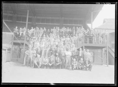 Glass negative, image of large group standing on a grandstand