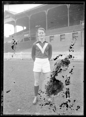 Glass negative, image of football player wearing Victorian representative guernsey