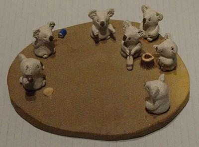 'The Cricket Game' - ceramic ornament featuring koalas playing cricket