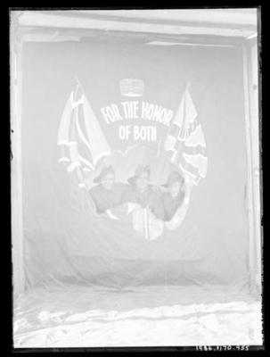 Glass negative, image of three unknown men in military attire with AIF flag