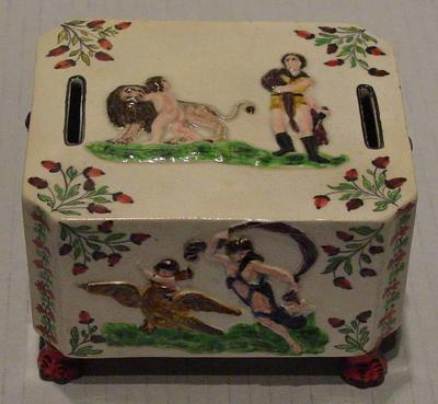 Money box, raised painted design