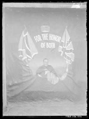 Glass negative, image of unknown man in military uniform with AIF flag