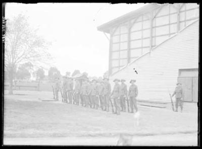 Glass negative, image of military group in formation