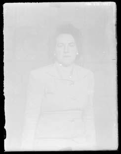 Glass negative, image of woman in jacket